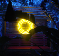 Yellow Neon in the garden as sculpture