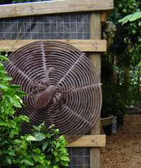 Recycled oil drum spider web garden sculpture