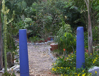 Recycled concrete house posts used at the garden entrance
