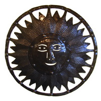 Sun face recycled oil drum carving from Haiti