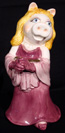 Miss Piggy vase, book, puppet